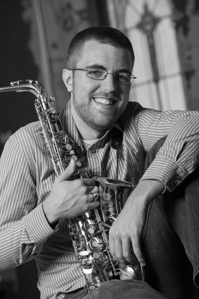 Dr. Adam Briggs with saxophone