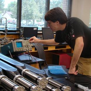 Student testing neutron detectors