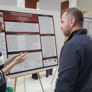Elizabeth Lindquist presents her poster at CUWiP 2017