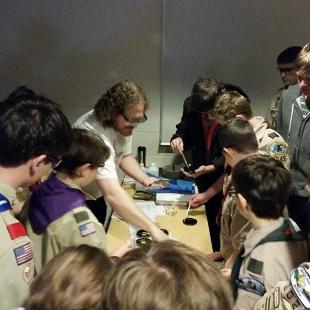 Boy Scouts build cloud chamber with Andrew Bunnell as part of Explore Center activity.