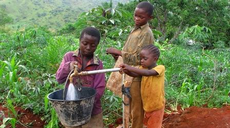Boys getting water from a well in Cameroon.