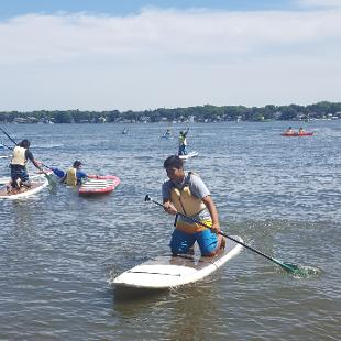 Summer students have fun on paddleboards
