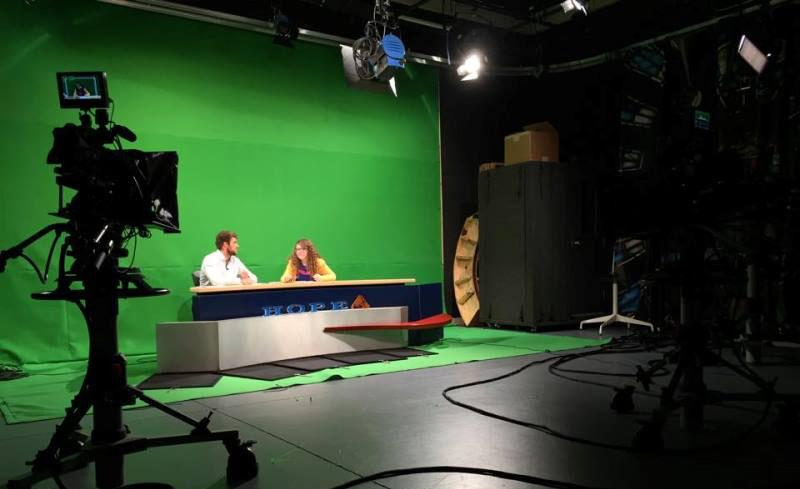 "Communication students Duncan McLean '16 and Nicole Metzler '16 get ready to record the student-run show ""Hope Update."""