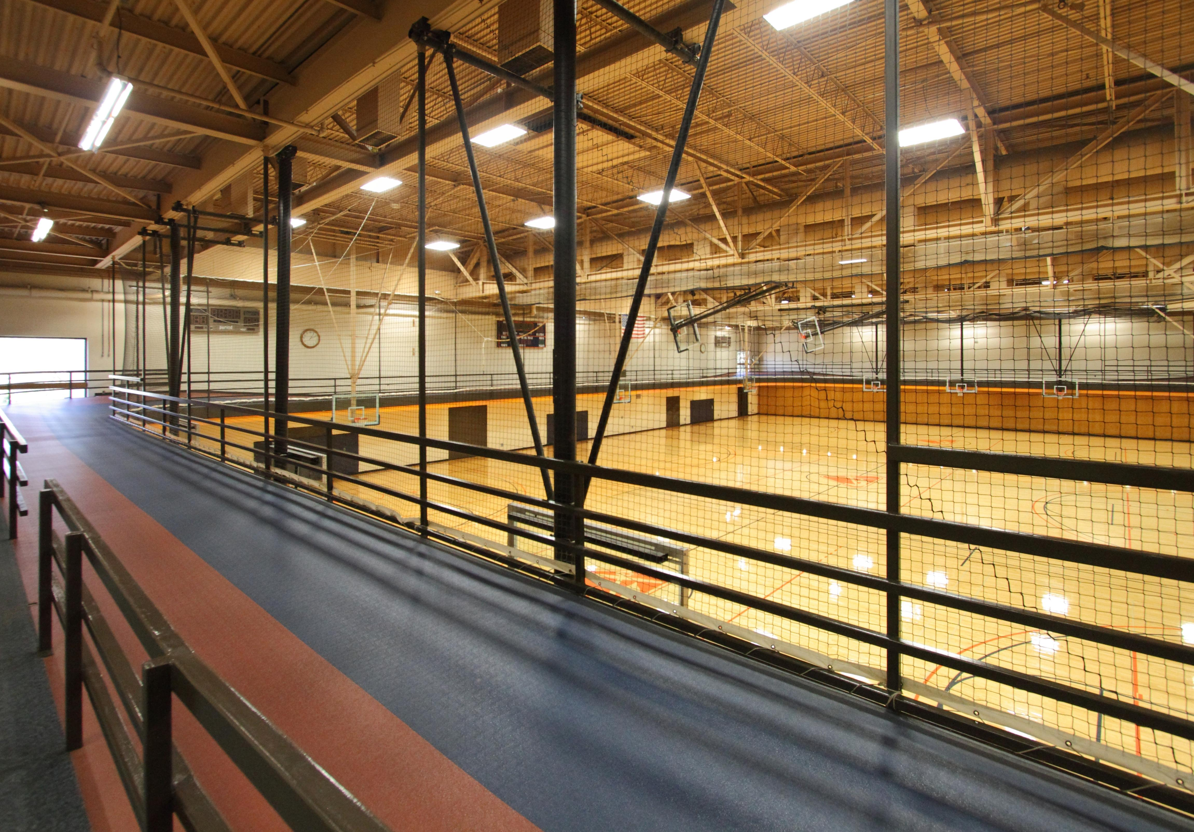 The 1/10 mile indoor track overlooks the basketball/volleyball courts.