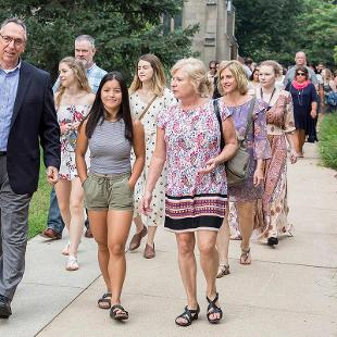 Families leaving Dimnent Memorial Chapel after the Orientation Worship Service held to Phelps Hall for lunch.