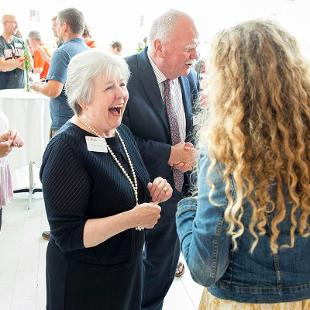President Dennis Voskuil and Betty Voskuil greet generational students and their families during a reception held in the lobby of the Jack H. Miller Center for Musical Arts.