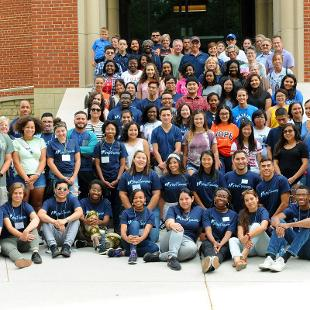 A group photo of students  participating in Step2Success pre-orientation program on the the steps of the Jim and Martie Bultman Student Center.