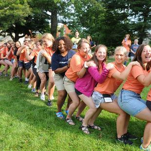 Members of the Orientation Staff get fired up to welcome the class of 2022.