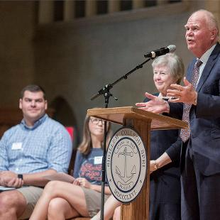 President Dennis Voskuil and Betty Voskuil welcome new students to campus in Dimnent Memorial Chapel.
