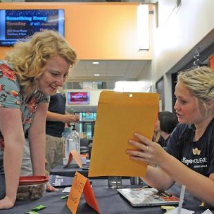 A new student asks questions at Orientation Station in the Jim and Martie Bultman Student Center.
