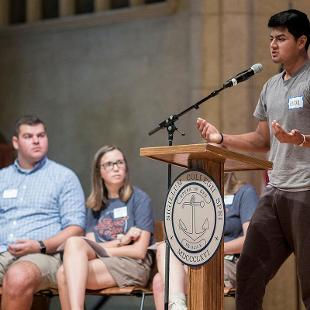 A male student leader addresses the new class of 2022 during opening session held in Dimnent Memorial Chapel.