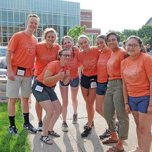 Orientation Assistants are ready to assist new students in getting their belonging into their new rooms.