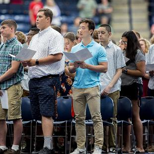 First Year Students sing during Convocation held in DeVos Fieldhouse.