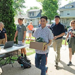 A new student moves into his residence hall.