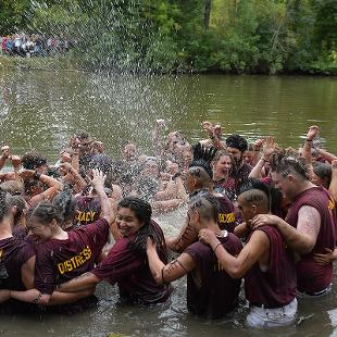 The sophomores celebrate their win in the Black River.