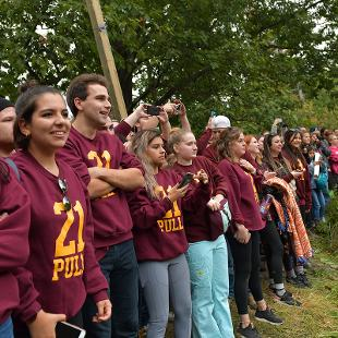 Alumni watch the opposite river bank as the pull time comes to an end.
