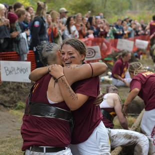 A puller and moraler hug after learning they won this year's Pull.