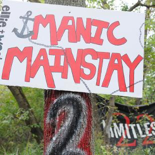"Sign that says ""Manic Mainstay"""