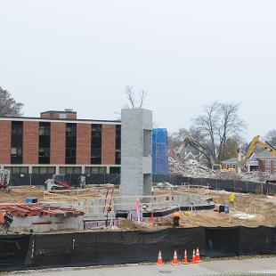 The elevator shaft of the Campus Ministries house is built and  and walls on the lower level are poured.