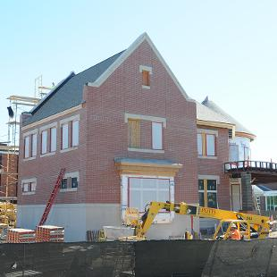 Brick work is being completed on the exterior wall of the Campus Ministries building.