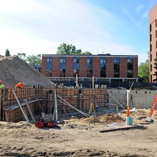 Forms have been erected for the walls of  lower level of the Campus Ministries house and walls are starting to be poured.