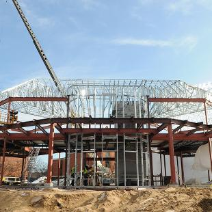 Tresles added to the project highlight the framework of the new Campus Ministries building.