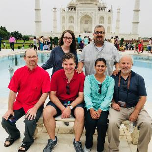 Hope professors smile in front of the Taj Mahal.