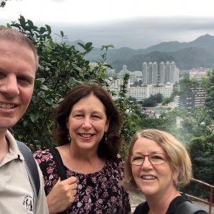 Hope professors smile in front of Hong Kong overlook