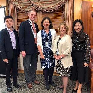 Hope professors smile with Lingnan University representatives