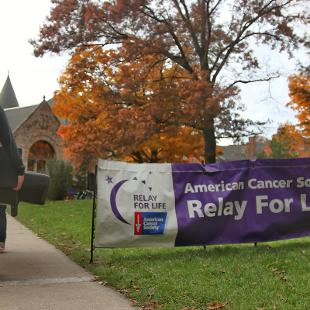 Student participating in Relay for Life arrive with a couch and other essentials for the evening.