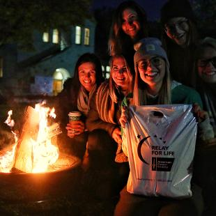 A fit pit brings warmth and light to the Relay for Life event.