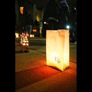 The  luminarias lighting the sideways in the Pine Grove honor those who have lost their lives to cancer and those who are still battling cancer.
