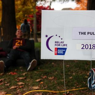 A 2018 Relay for Life sign is surround by fallen leaves as the event kicks off for this fall.
