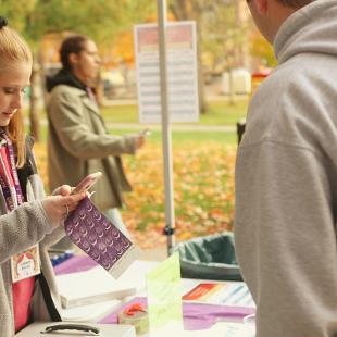 A female student registers participants for this year's Relay for Life
