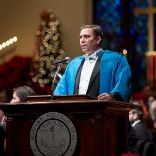 Rev. Trygve Johnson participates in the service.