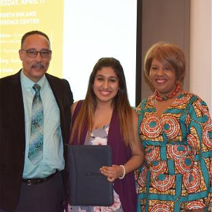 Senior recognition for all graduating students of color. Hope student posing with John Yelding and Vanessa Green.