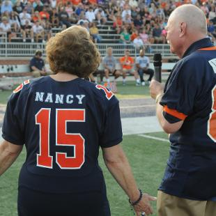Mayor Nancy deBoer and President Dennis Voskuil speak at the Community Day football game.