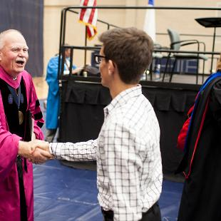 Dennis Voskuil meets students at opening convocation.