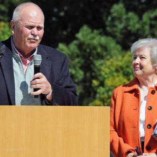 Dennis and Betty Voskuil speak during Community Day