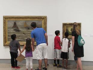 Students from the CASA program studying artworks in the Kruizenga Art Museum.