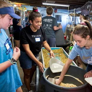 Hope students helpi care for the animals and facilities at the Critter Barn.