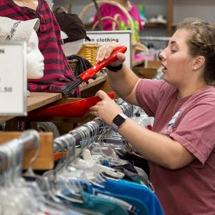 Students do cleaning and sorting at Bibles for Mexico Thrift store.