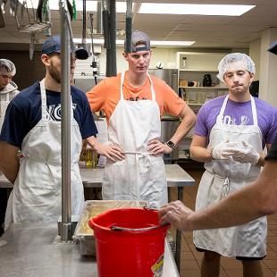 Volunteers do lunch prep sort food donations and organize pantry as well as cleaning at the Men's  Ministry Center at Holland Rescue Mission.