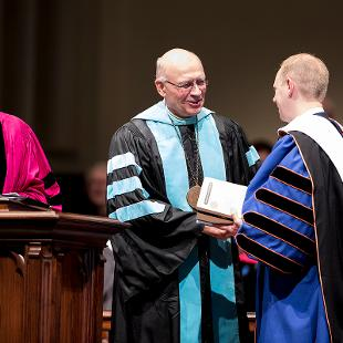 President Emeritus Dennis Voskuil, President Emeritus James Bultman give President Matt Scogin books they think he will value.