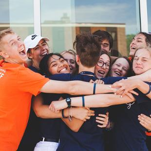 A group of Awakening students hugging