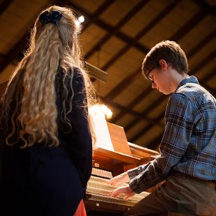 A student playing the organ