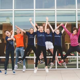 A group of Awakening students jumping in the air