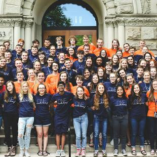 Awakening students, staff and interns on the steps of Graves Hall