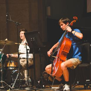 Students playing the cello and drums