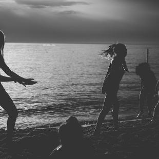 Students dancing on the beach